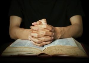 man-praying-bible-bsm-667x476